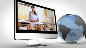 Videos of healthy cooking on devices with an earth courtesy of Nasa.org Stock Photo