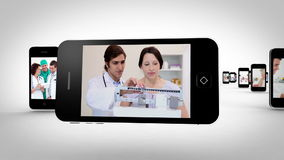 Videos of a hospital on smartphones Royalty Free Stock Images
