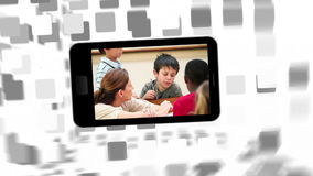 Videos of a primary classroom on a smartphone screen Royalty Free Stock Photo