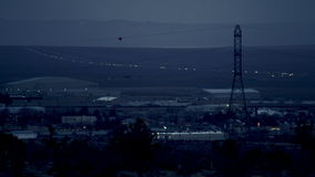 The videoshot of the evening countryside. With lights seen from buildings and the valley on the horizon stock video