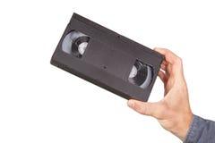 Videotape, videocassette in hand. Stock Image