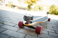 Videotaping on longboard. Longboard equipped with two extreme cameras Royalty Free Stock Photos