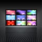 Videowand mit abstrakten Leuchten auf den Bildschirmen Stockbilder