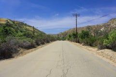 Videz la route arrière de collines Images stock