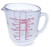 Videz la tasse en verre liquide de mesure sur le fond blanc Images libres de droits