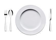 Videz le plat plat avec la cuillère, le couteau et la fourchette d'isolement sur le fond blanc Photographie stock