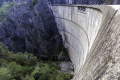 Vidraru Dam in Transfagarasan, Romania. An aerial view of the Vidraru Dam in Romania. The road on top of the dam walls is located in the Fagaras mountains and Royalty Free Stock Image