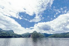 Vidraru Lake from local chalet. Wide view. Blue sky and clouds on background. Place for text. Fagaras Mountains, Romania royalty free stock images