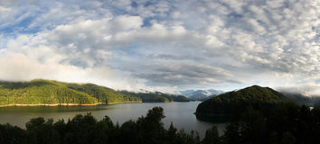 Vidraru lake and mountains panorama. High panoramic view of Vidraru lake in a sunny day with calm weather Stock Photos