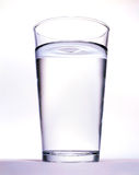Vidrio con agua Imágenes de archivo libres de regalías