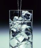 Vidrio con agua y el hielo Fotos de archivo libres de regalías