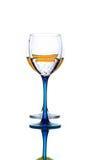 Vidrio con el líquido anaranjado Fotografía de archivo libre de regalías