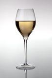 Vidrio con el vino blanco Imagen de archivo