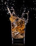 Vidrio con el whisky Foto de archivo libre de regalías