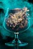 Vidrio con joyería en humo Imagen de archivo
