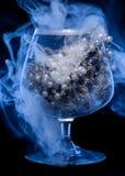 Vidrio con joyería en humo Foto de archivo libre de regalías