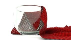 Vidrio con la servilleta Foto de archivo libre de regalías