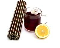 Vidrio con las bebidas de la hierba del color rojo Foto de archivo