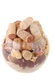 Vidrio con los tapónes de las botellas de vino Foto de archivo libre de regalías