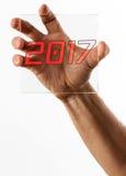 Vidrio conmovedor de la mano con el texto 2017 Foto de archivo libre de regalías