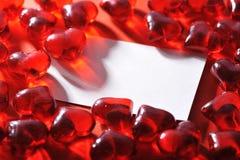 Vidrio-corazones rojos Fotos de archivo