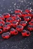 Vidrio-corazones rojos Imagen de archivo