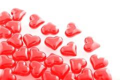 Vidrio-corazones rojos Fotos de archivo libres de regalías