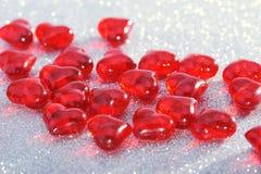Vidrio-corazones rojos Imágenes de archivo libres de regalías