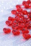 Vidrio-corazones rojos Imagenes de archivo
