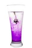 Vidrio de agua con tinta Imagenes de archivo