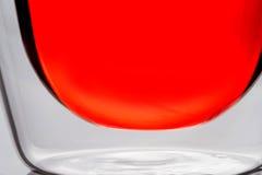Vidrio de agua roja Imágenes de archivo libres de regalías