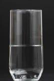 Vidrio de agua semilleno Imágenes de archivo libres de regalías