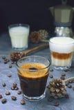 Vidrio de café caliente del café express y del capuchino Foto de archivo
