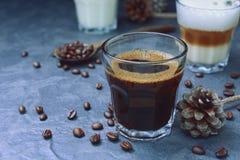 Vidrio de café caliente del café express y del capuchino Imagenes de archivo
