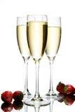 Vidrio de champán con la fresa Foto de archivo
