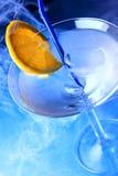 Vidrio de coctel con la rebanada anaranjada Fotografía de archivo libre de regalías