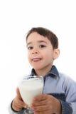 Vidrio de consumición del niño de leche Fotografía de archivo
