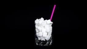 Vidrio de cubos del azúcar Fotos de archivo