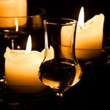 Vidrio de Grappa y de velas Imágenes de archivo libres de regalías