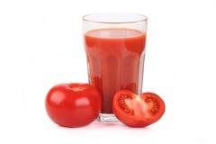 Vidrio de jugo de tomate Fotos de archivo