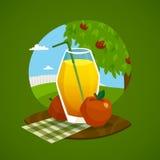 Vidrio de Juice With Rural Landscape Background Imagen de archivo libre de regalías