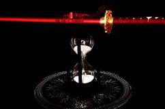 Vidrio de la espada y de la hora Foto de archivo