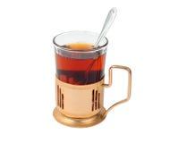 Vidrio de té caliente en vidrio-sostenedor Foto de archivo libre de regalías