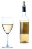 Vidrio de vino blanco con una botella Imágenes de archivo libres de regalías