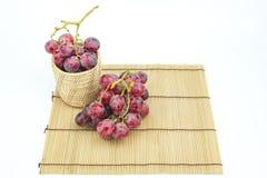 Vidrio de vino con la uva Imagen de archivo