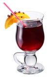 Vidrio de vino reflexionado sobre adornado con la naranja Imagen de archivo