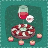 Vidrio de vino rojo y de ensalada Caprese Foto de archivo