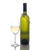 Vidrio de vino y botella de vino Foto de archivo libre de regalías
