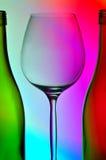 Vidrio de vino y dos botellas imagen de archivo libre de regalías