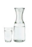 Vidrio del agua y de la jarra Fotografía de archivo